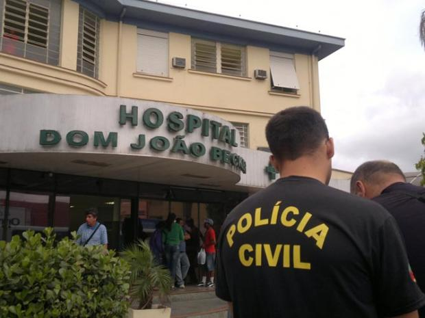 Police outside hospital where 25-year-old Diego Telles de Carvalho was gunned down on Monday while recuperating from a Saturday night shooting