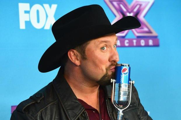 Cantor country Tate Stevens é o vencedor do reality musical 'The X Factor' Frazer Harrison/AFP