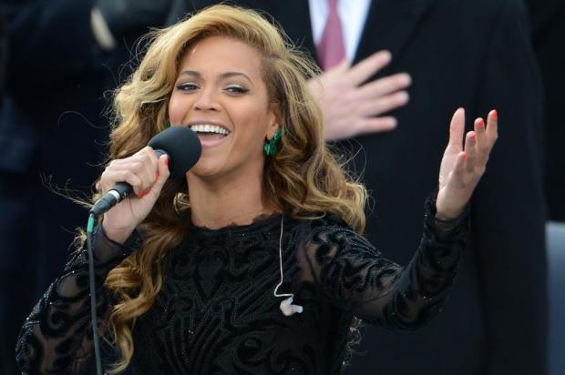 Beyoncé admite playback na posse de Obama Stan Honda/AFP