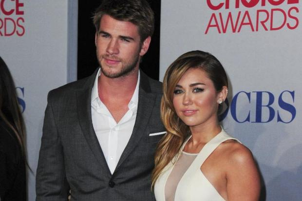 Termina noivado de Miley Cyrus e Liam Hemsworth, diz jornal Robyn Beck/AFP