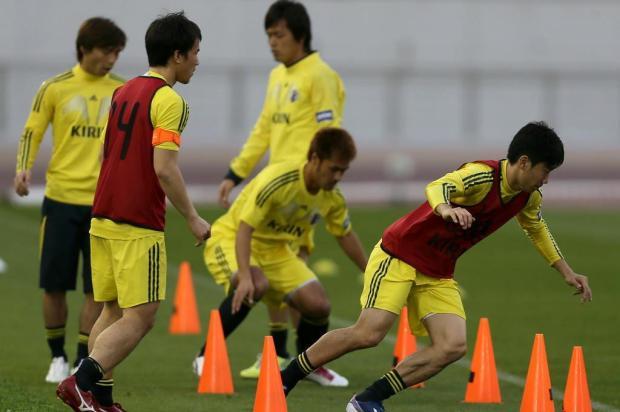 Japão deve ser a primeira seleção classificada para o Mundial no Brasil AL-WATAN DOHA/KARIM JAAFAR/AFP