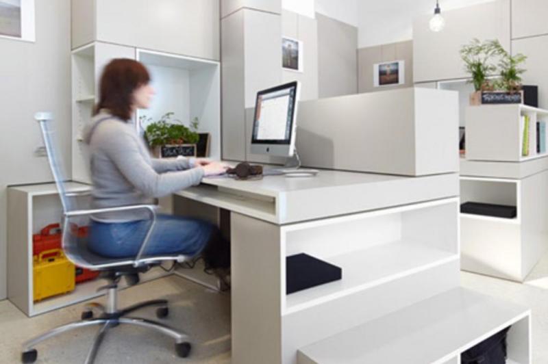 Mesmo assim, a volumetria de cada mesa garante áreas mais privadas para cada funcionário:imagem 9