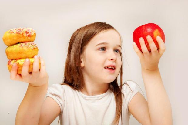 Usar comida como recompensa pode prejudicar hábitos alimentares das crianças Kylie Walls/Deposit Photos