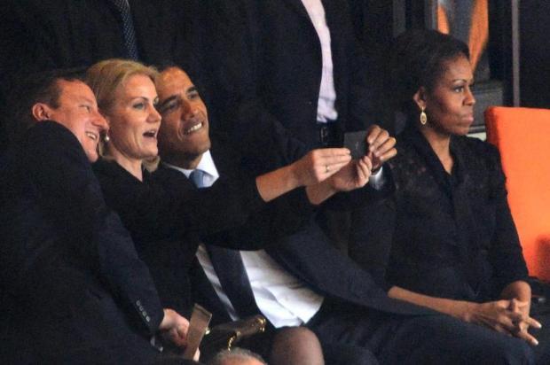 Foto de Obama e Michelle gera especulação sobre ciúme nas redes sociais Roberto Scmidt/AFP