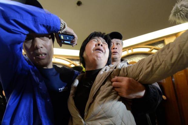"""""""Não há sobreviventes"""", diz Malaysia Airlines a familiares GOH CHAI HIN/AFP"""