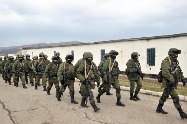 EUA: Rússia pode perder lugar no G8 se continuar com 'invasão da Crimeia' Genya Savilov/AFP